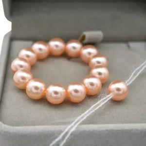 Brand new! Infant pink pearl bracelet w/ tieback